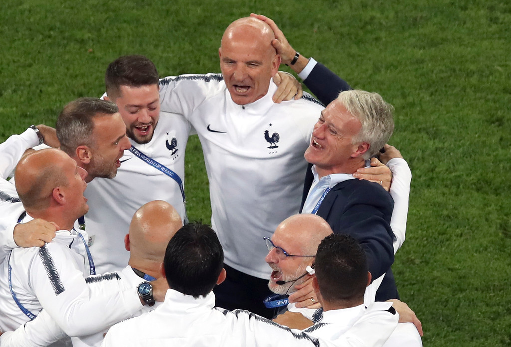 . France head coach Didier Deschamps, right, celebrates with his team staff at the end of the semifinal match between France and Belgium at the 2018 soccer World Cup in the St. Petersburg Stadium in St. Petersburg, Russia, Tuesday, July 10, 2018. (AP Photo/Thanassis Stavrakis)
