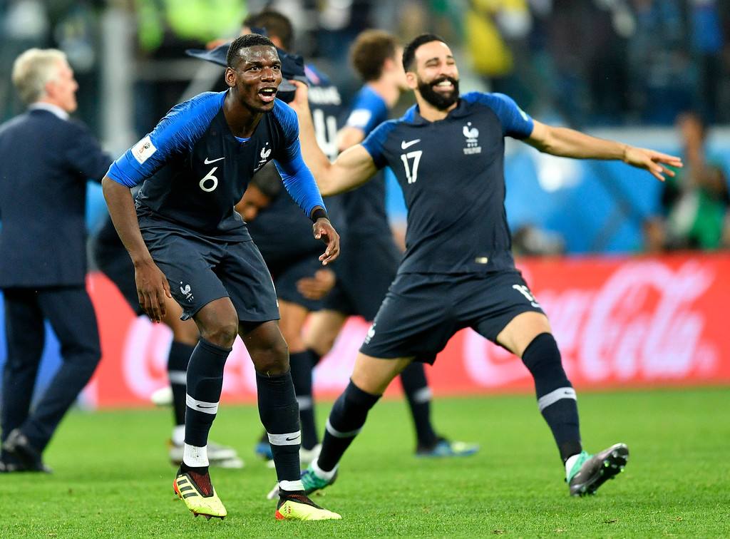 . France\'s Paul Pogba, left, celebrates with Adil Rami after their team advanced to the final during the semifinal match between France and Belgium at the 2018 soccer World Cup in the St. Petersburg Stadium in St. Petersburg, Russia, Tuesday, July 10, 2018. (AP Photo/Martin Meissner)
