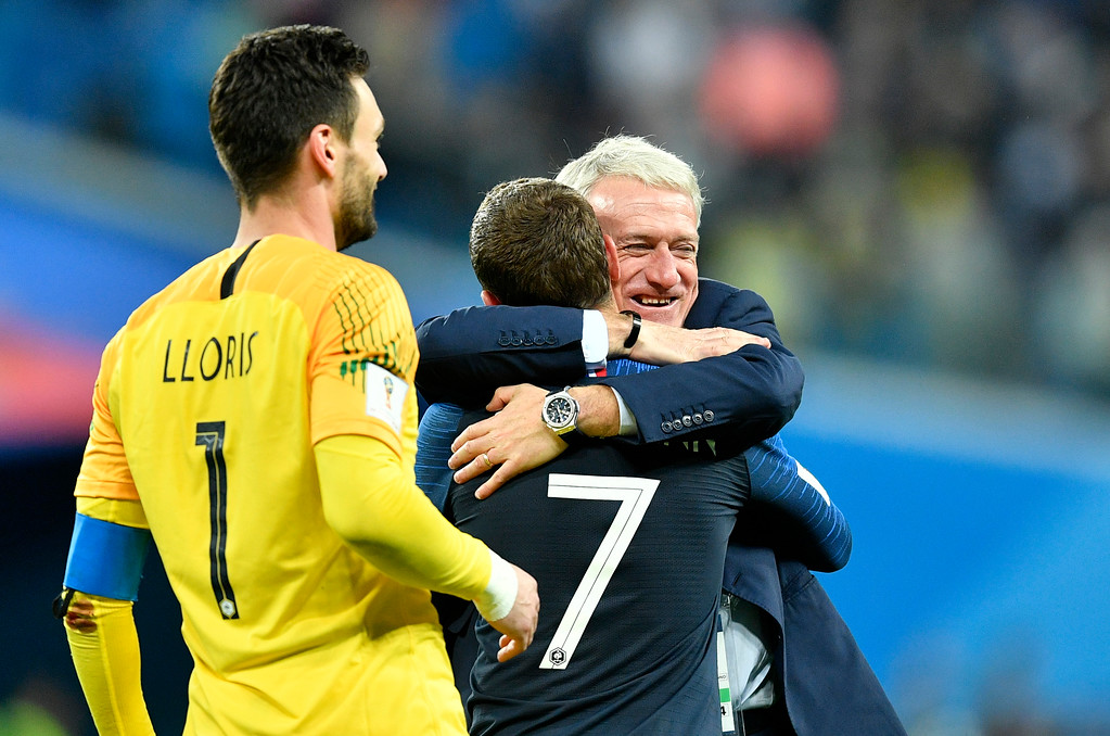 . France head coach Didier Deschamps, right, hugs Antoine Griezmann after their team advanced to the final after the semifinal match between France and Belgium at the 2018 soccer World Cup in the St. Petersburg Stadium in St. Petersburg, Russia, Tuesday, July 10, 2018. (AP Photo/Martin Meissner)