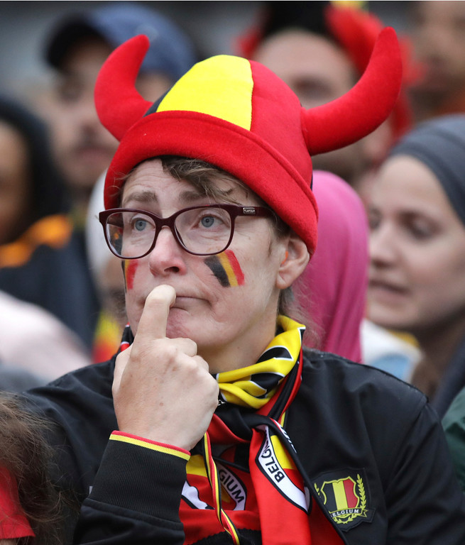 . Belgium fans watch a 2018 World Cup semifinal soccer match between France and Belgium on a giant screen in Jette, Belgium, Tuesday, July 10, 2018. (AP Photo/Olivier Matthys)