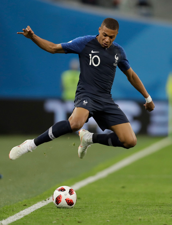. France\'s Kylian Mbappe leaps over the ball during the semifinal match between France and Belgium at the 2018 soccer World Cup in the St. Petersburg Stadium in, St. Petersburg, Russia, Tuesday, July 10, 2018. (AP Photo/Natacha Pisarenko)
