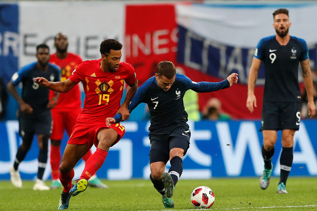 . Belgium\'s Moussa Dembele, left, and France\'s Antoine Griezmann challenge for the ball during the semifinal match between France and Belgium at the 2018 soccer World Cup in the St. Petersburg Stadium in, St. Petersburg, Russia, Tuesday, July 10, 2018. (AP Photo/Frank Augstein)