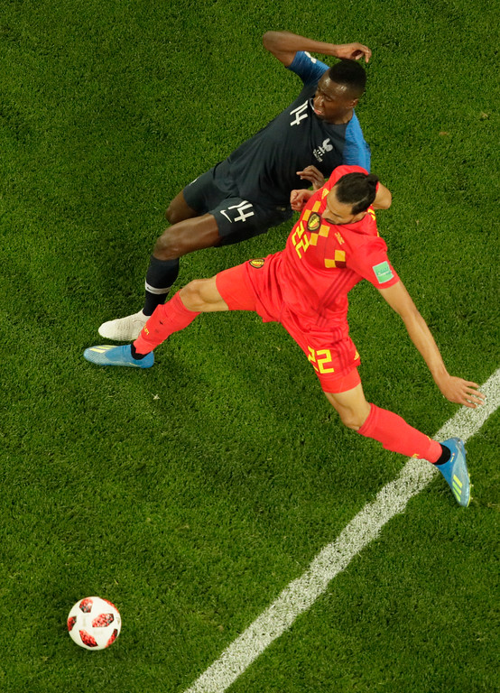 . France\'s Blaise Matuidi, left, is challenged by Belgium\'s Nacer Chadli during the semifinal match between France and Belgium at the 2018 soccer World Cup in the St. Petersburg Stadium in St. Petersburg, Russia, Tuesday, July 10, 2018. (AP Photo/Dmitri Lovetsky)