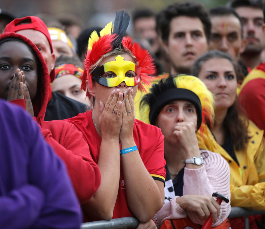 . Belgium fans react as they watch a 2018 World Cup semifinal soccer match between France and Belgium on a giant screen in Jette, Belgium, Tuesday, July 10, 2018. (AP Photo/Olivier Matthys)