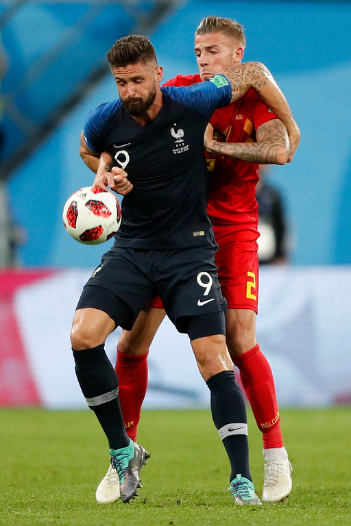 . France\'s Olivier Giroud, foreground, and Belgium\'s Toby Alderweireld challenge for the ball during the semifinal match between France and Belgium at the 2018 soccer World Cup in the St. Petersburg Stadium in, St. Petersburg, Russia, Tuesday, July 10, 2018. (AP Photo/Frank Augstein)