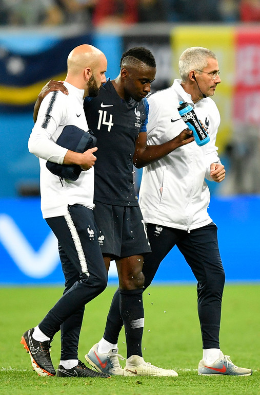 . France\'s Blaise Matuidi is led of the field during the semifinal match between France and Belgium at the 2018 soccer World Cup in the St. Petersburg Stadium in St. Petersburg, Russia, Tuesday, July 10, 2018. (AP Photo/Martin Meissner)