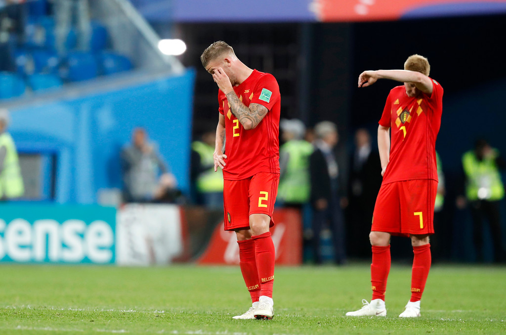 . Belgium\'s Toby Alderweireld, left, and Belgium\'s Kevin De Bruyne stand on the pitch at the end of the semifinal match between France and Belgium at the 2018 soccer World Cup in the St. Petersburg Stadium, in St. Petersburg, Russia, Tuesday, July 10, 2018. (AP Photo/David Vincent)