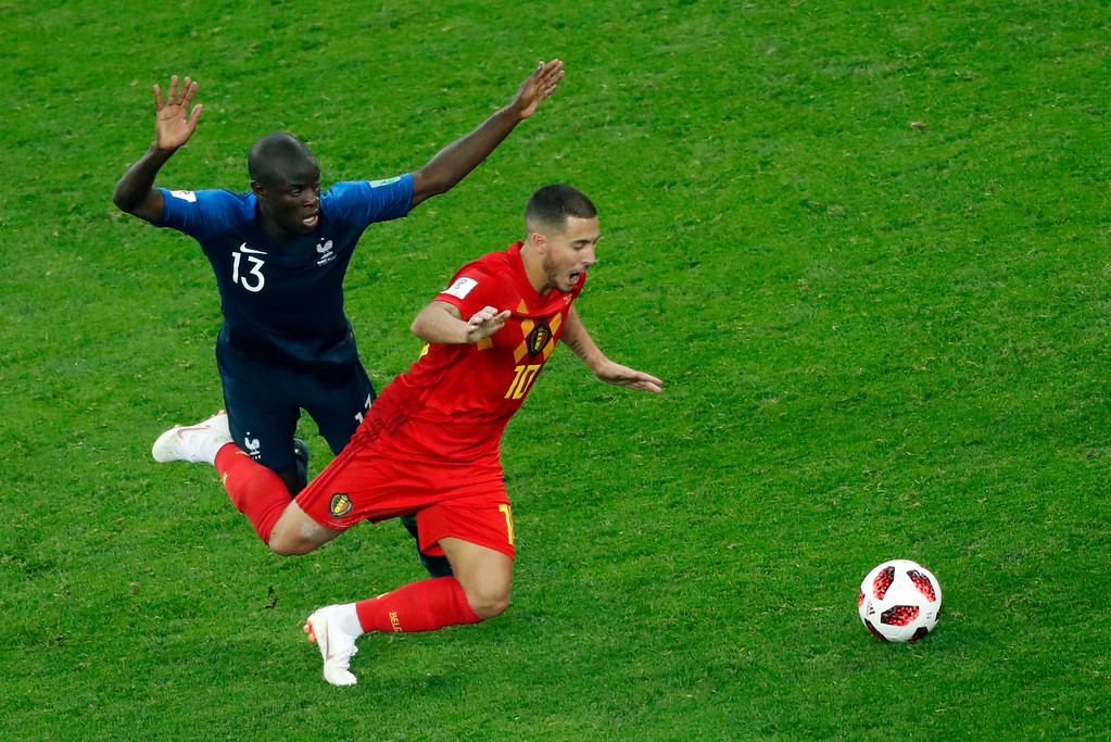 . France\'s Ngolo Kante, left, duels for the ball with Belgium\'s Eden Hazard during the semifinal match between France and Belgium at the 2018 soccer World Cup in the St. Petersburg Stadium in St. Petersburg, Russia, Tuesday, July 10, 2018. (AP Photo/Pavel Golovkin)
