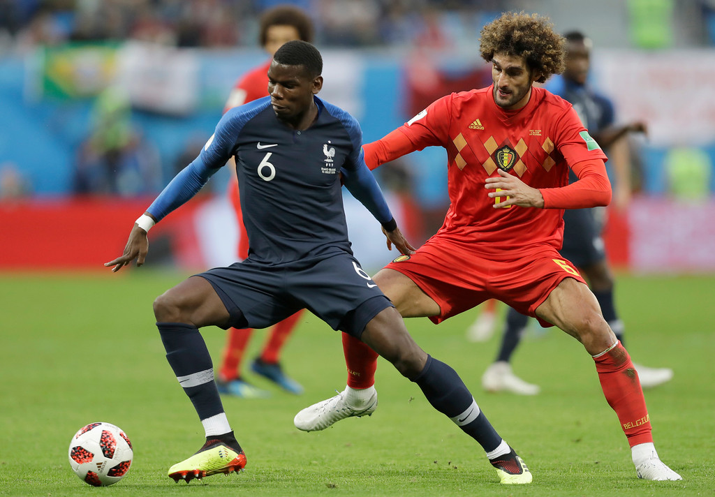 . France\'s Paul Pogba, left is challenged by Belgium\'s Marouane Fellaini for the ball during the semifinal match between France and Belgium at the 2018 soccer World Cup in the St. Petersburg Stadium in, St. Petersburg, Russia, Tuesday, July 10, 2018. (AP Photo/Natacha Pisarenko)