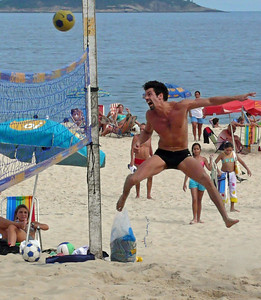 Beach volleyball on Ipanema Beach - Rio de Janeiro, Brazil (2007). This image became a finalist in the Nikon Moving Moments 2008 contest. Copyright © 2007 Alex Emes