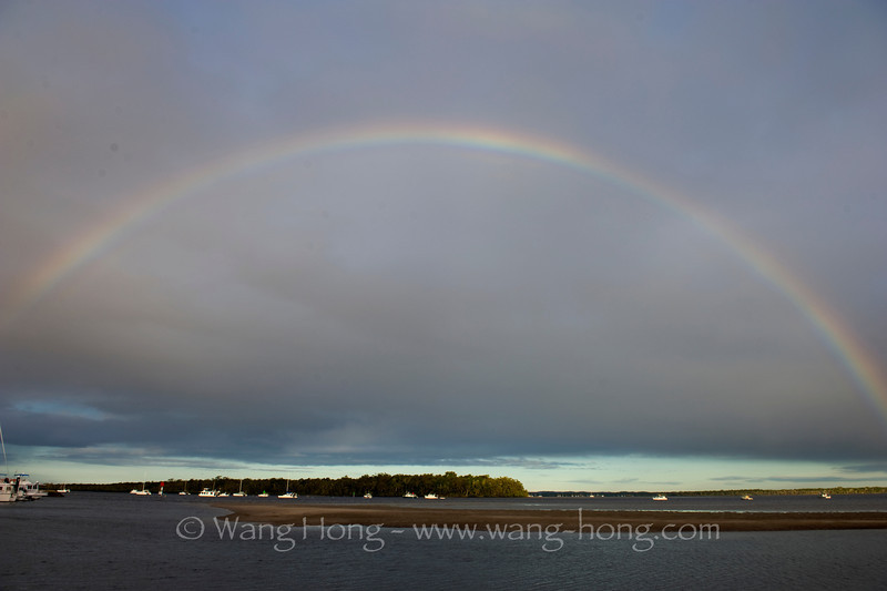 Rainbow Beach, an entry point to Fraser Island. As we drove into town, we saw this beautiful full raibow over the grey sky.