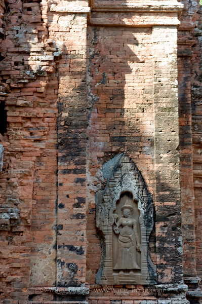 Apsara on the wall of the early Angkorian temple of Lorei