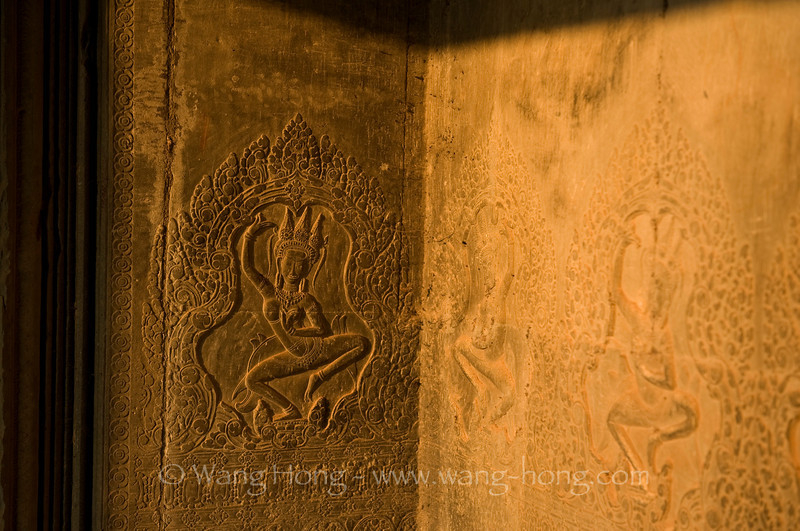 Dancing apsara in the light of setting sun, at Angkor Wat