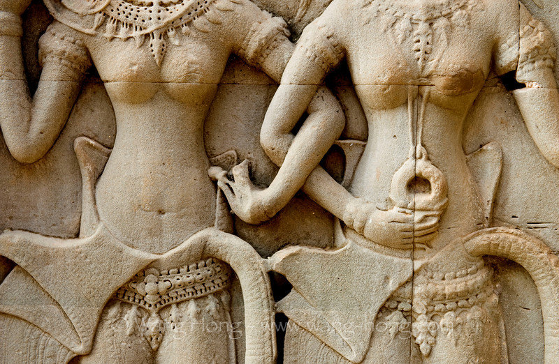 Apsaras arm in arm at Angkor Wat