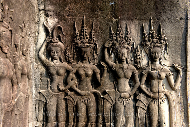 Apsaras with excessive head pieces at Angkor Wat