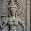 Apsara holding a flower branche, at Angkor Wat