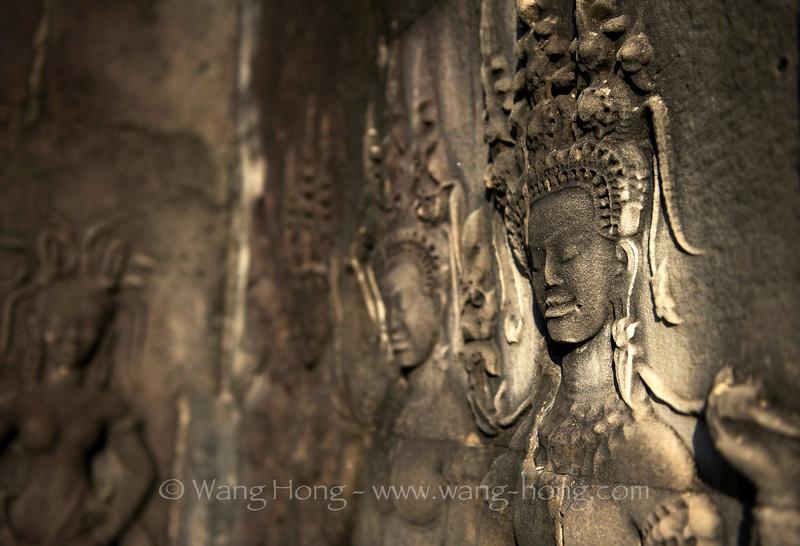 Apsara in a mysterious smile at Angkor Wat