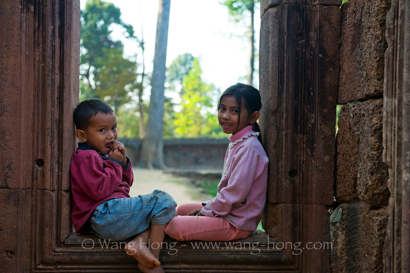 Sister and brother (cleaner's children) playing at Banteay Srei