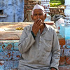 Smoking old man on bank of River Yamuna