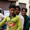 Young men on a motor bike on street of Agra