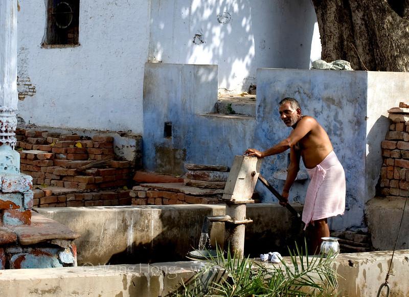 Morning shower in village outside Taj Mahal, on bank of Yamuna River