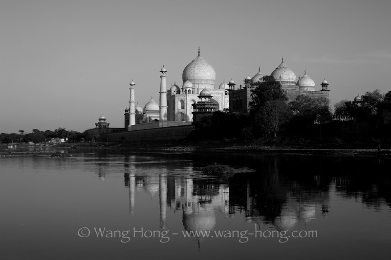 Taj Mahal shortly before sunset over Yamuna River.