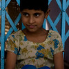Girl quietly smiling in village outside Taj Mahal, Agra