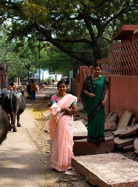 Indian ladies in beautiful saris in the village outside Taj Mahal.