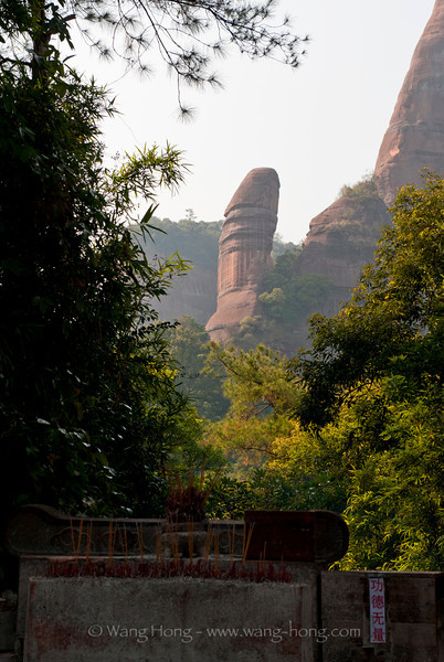 A funny rock formation, Yangyuan Rock, in Danxia landscape being worshiped as a source of male vitality.