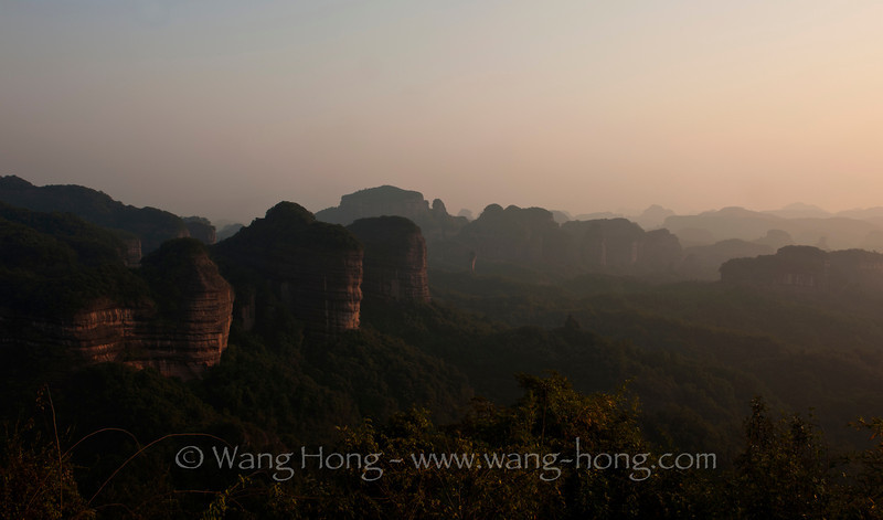 Late afternoon light shines over the Danxia landscape in Guangdong, China.
