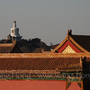 The white pagoda seen over the roofs of the Forbidden City, Beijing 从故宫望北海白塔