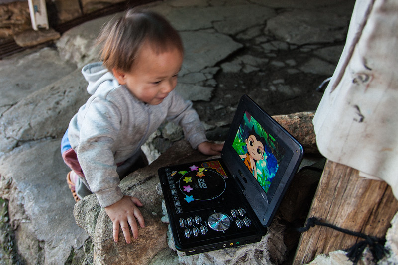 Toddler Watching Cartoon, Chiang Mai, Thailand