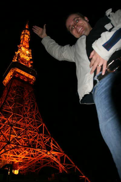 I had to share this one: me next to the Tokyo Tower.<br /> This is a fun thing to do: Have someone lay down and take a photo with the camera facing up.  It makes you look like a giant.