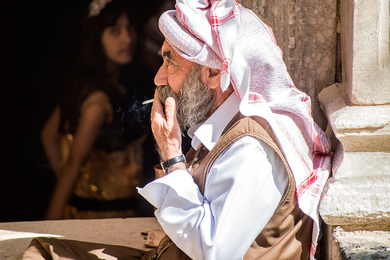 Iraq Lalish 20130913 Man watching the doorstep to a sacred temple in Lalish. Lalish is one of the most sacred place on earth for all practioners of the Yazidi faith. The tradition bids every Yazidi to visit this place on in a lifetime. This is where their deity Malak Taus is supposed to be first landed. Some people also believe that Noah's Ark came to rest here. Visitors must walk barfoot once inside the sacred temples. The interior contains several tombs, one is believed to be the tomb of Sheikh Adi ibn Mustafa Photo Maria Langen / Sverredal & Langen AB