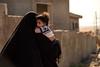 Iraq Kurdistan 20130913<br /> Woman with a child at the Domiz refugee camp in Kurdistan <br /> Photo Maria Langen / Sverredal & Langen AB