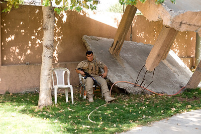 Sulymaniyah 20130916 Guard at the Red Security Museum (Amna Suraka). The museum is known as the Red Security due to the red color of the security building used by the Baath regime (Saddam Hussein). Part of the prison exhibits torture and death at that the time. The site has partly been kept as it was when a kurdish resistance group took  it over1991. Photo Maria Langen / Sverredal & Langen AB
