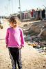 Iraq Kurdistan 20130913<br /> Girl outside the fence of the Domiz refugee campi in Kurdistan <br /> Photo Maria Langen / Sverredal & Langen AB