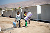 "Iraq Kurdistan 20130915<br /> Girls carrying mattresses to a tent in a refugee camp close to the village of Basrma in Kurdistan. As many as 5000 Syrians refugees could be staying in this ""new"" camp, waiting for the surrounding world to support them in where to go next<br /> Photo Maria Langen / Sverredal & Langen AB"