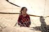 Iraq Kurdistan 20130913<br /> Girl behind the fence of the Domiz refugee campi in Kurdistan <br /> Photo Maria Langen / Sverredal & Langen AB