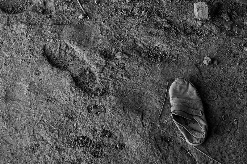 """Iraq Kurdistan Koy Sanjaq 20130915<br /> Shoe beside a footprint in a ruin in Koy Sanjaq """"Koya""""  in the state/region of Arbīl <br /> Photo Maria Langen / Sverredal & Langen AB"""