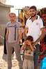 Iraq Kurdistan 20130913<br /> Men with a sad boy at the Domiz refugee campi in Kurdistan <br /> Photo Maria Langen / Sverredal & Langen AB
