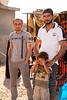 Iraq Kurdistan 20130913<br /> Men with a sad boy at the Domiz refugee campi in Kurdistan <br /> Photo Maria Langen / Sverredal & Langen AB