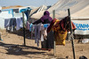 Iraq Kurdistan 20130913<br /> Woman with her laundry at the Domz refugee campi in Kurdistan <br /> Photo Maria Langen / Sverredal & Langen AB