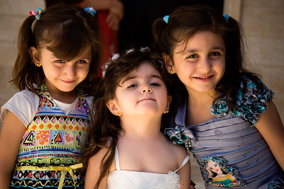 "Kurdistan Al-Kosh (MarMattai) 20130913 Girls visiting the Mar Matti Monastery. So do many pilgrims and Kurds and a few tourist every year. THe girls are dressed up for a christening ceremony. Mar Matti Monastery is located at the top of the ""upside down mountain"" Jabal Maqlub in northern Iraq / Kurdistan (about 20 kilometers from Mosul and south of Dahuk). Dating back to the 4th century A.D Mar Matti was founded by the Syriac Christian Matti (Syriac for Matthew). He joined a mostly Nestorian population that had a small Syriac community. Using many of the caves on Jabal Maqlub as a temporary home, eventually the monastery was built to make life a little more comfortable. Under the leadership of Matti the community developed a monastic ethos. It is today recognized as one of the oldest Christian monasteries in existence."