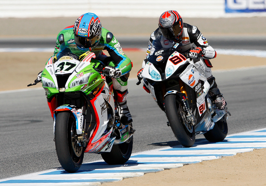 . Ondrej Jezek (37) leads Jordi Torres (81) during a practice session at the FIM Superbike World Championship at Mazda Raceway Laguna Seca on Friday, July 7, 2017.  (Vern Fisher - Monterey Herald)