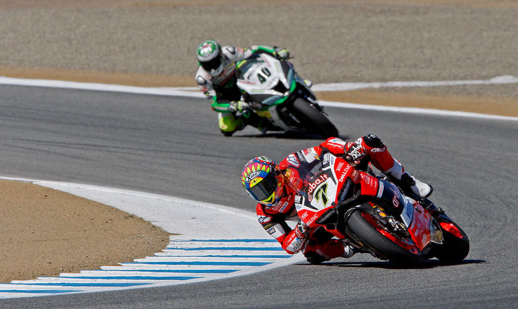 . Chaz Davies (7) leads Ramon Ramos through turn-3 during a practice session at the FIM Superbike World Championship at Mazda Raceway Laguna Seca on Friday, July 7, 2017.  (Vern Fisher - Monterey Herald)
