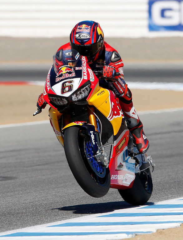 . Stefan Bradl (6) from Germany gets his Honda CBR1000RR on one wheel out of turn-3 during practice session at the FIM Superbike World Championship at Mazda Raceway Laguna Seca on Friday, July 7, 2017.  (Vern Fisher - Monterey Herald)