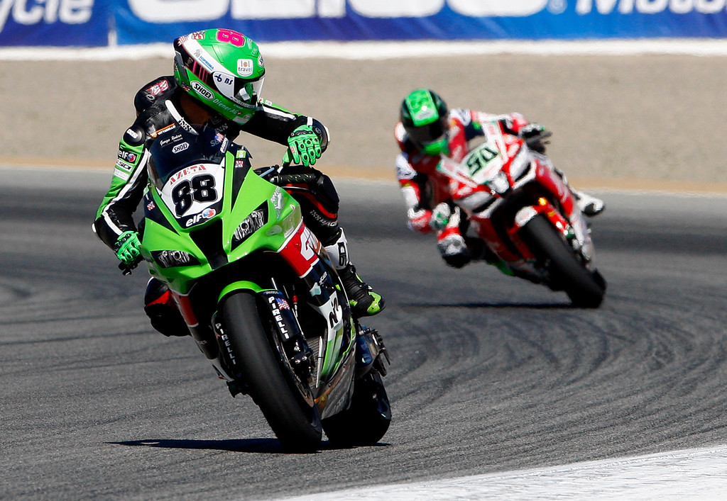 . Randy Krummenacher (88) checks on Eugene Laverty (50) coming out of turn-3 during a practice session at the FIM Superbike World Championship at Mazda Raceway Laguna Seca on Friday, July 7, 2017.  (Vern Fisher - Monterey Herald)