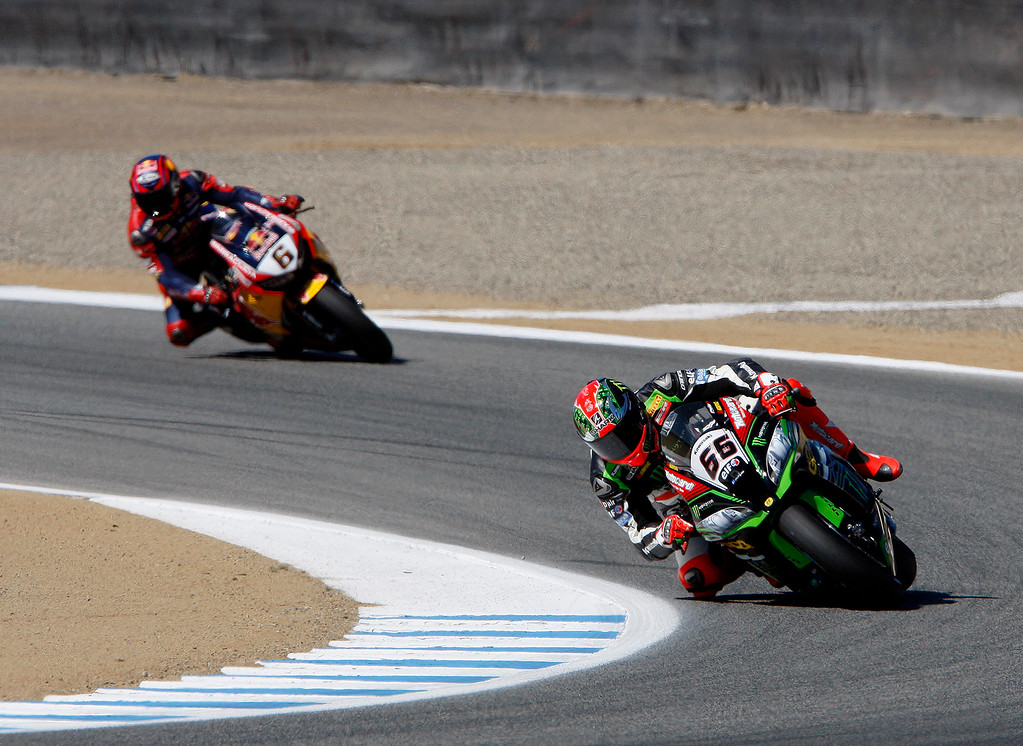 . Tom Sykes (66) leads Stefan Bradl (6) through turn-3 during a practice session at the FIM Superbike World Championship at Mazda Raceway Laguna Seca on Friday, July 7, 2017.  (Vern Fisher - Monterey Herald)