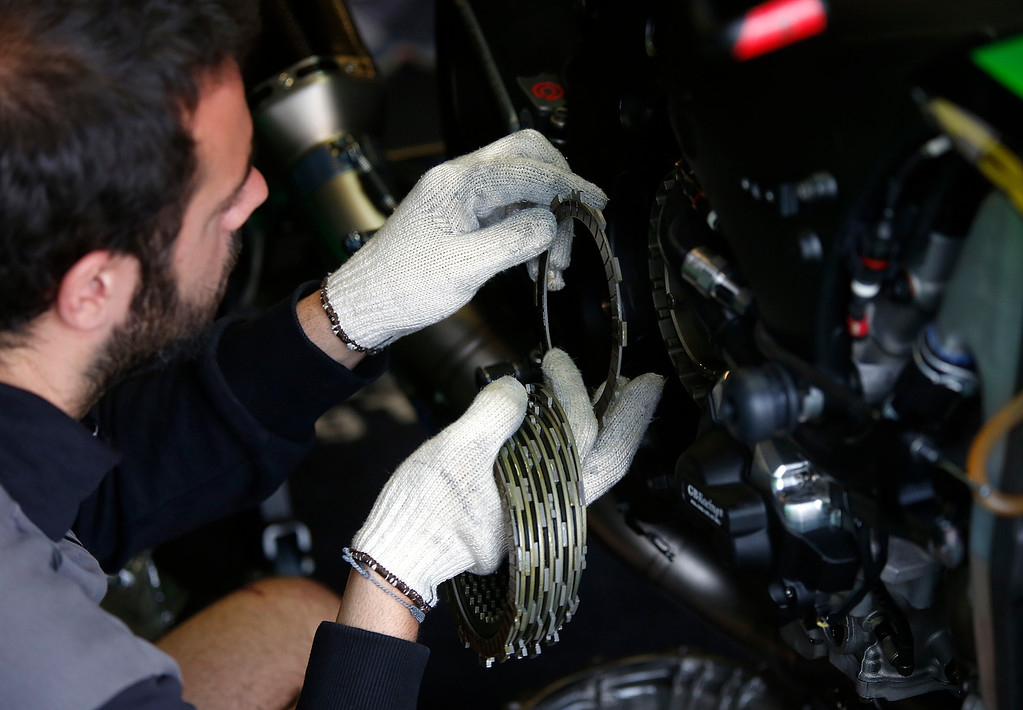 . A mechanic replaces clutch plates on Kawasaki Racing Team rider Jonathan Rea\'s motorcycle during the Superbike World Championship at Laguna Seca Raceway in Monterey on Sunday June 24, 2018.   (David Royal/ Herald Correspondent)